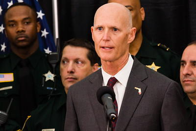 Florida Governor Rick Scott speaks during a news conference on Monday, April 14, 2016, where he signed a ceremonial bill on a piece of victims' rights legislation at the Palm Beach County Sheriff's Office in West Palm Beach.  (Joseph Forzano / The Palm Beach Post)