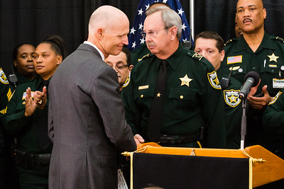 Palm Beach County Sheriff Ric Bradshaw and Florida Governor Rick Scott shake hands  during a news conference on Monday, April 14, 2016, where Rick Scott signed a ceremonial bill on a piece of victims' rights legislation at the Palm Beach County Sheriff's Office in West Palm Beach.  (Joseph Forzano / The Palm Beach Post)