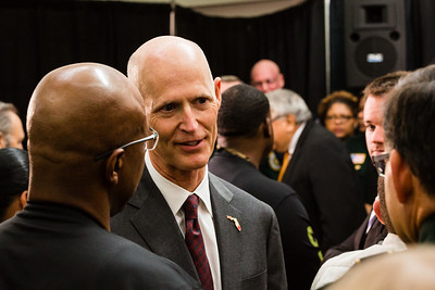 Florida Governor Rick Scott shakes hands with law enforcement officers who witnessed him sign the ceremonial bill on victims' rights legislation at the Palm Beach County Sheriff's Office in West Palm Beach on  Monday, April 14, 2016. (Joseph Forzano / The Palm Beach Post)