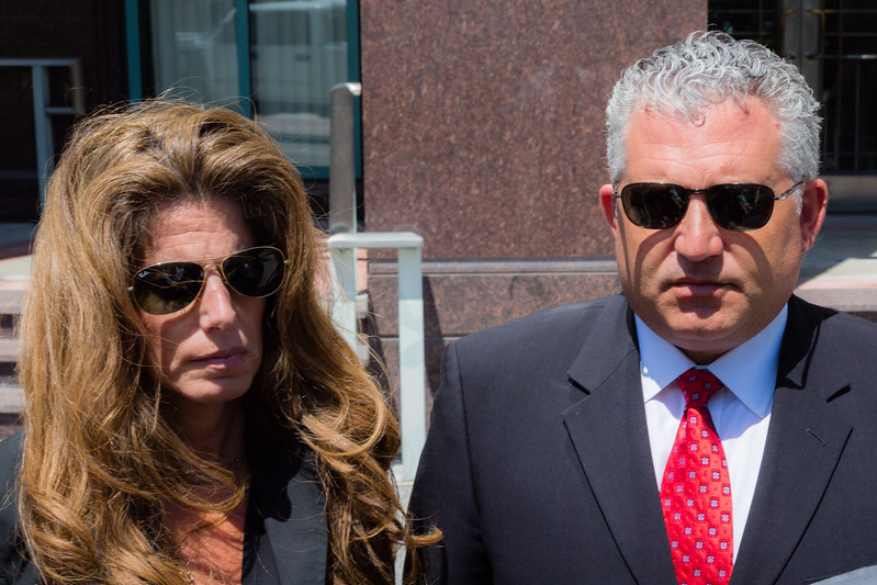 Pamela Cohen and Nick Korniloff after leaving the State Attorney's Office with their lawyer on Monday, April 26, 2016. The attorney for the family of Perry Cohen said the phone that was found on the missing boys' boat will stay with the Florida Fish and Wildlife Conservation Commission. The attorney said the family filed a lawsuit on Sunday to stop law enforcement from releasing to the iPhone to the Stephanos family. (Joseph Forzano / The Palm Beach Post)