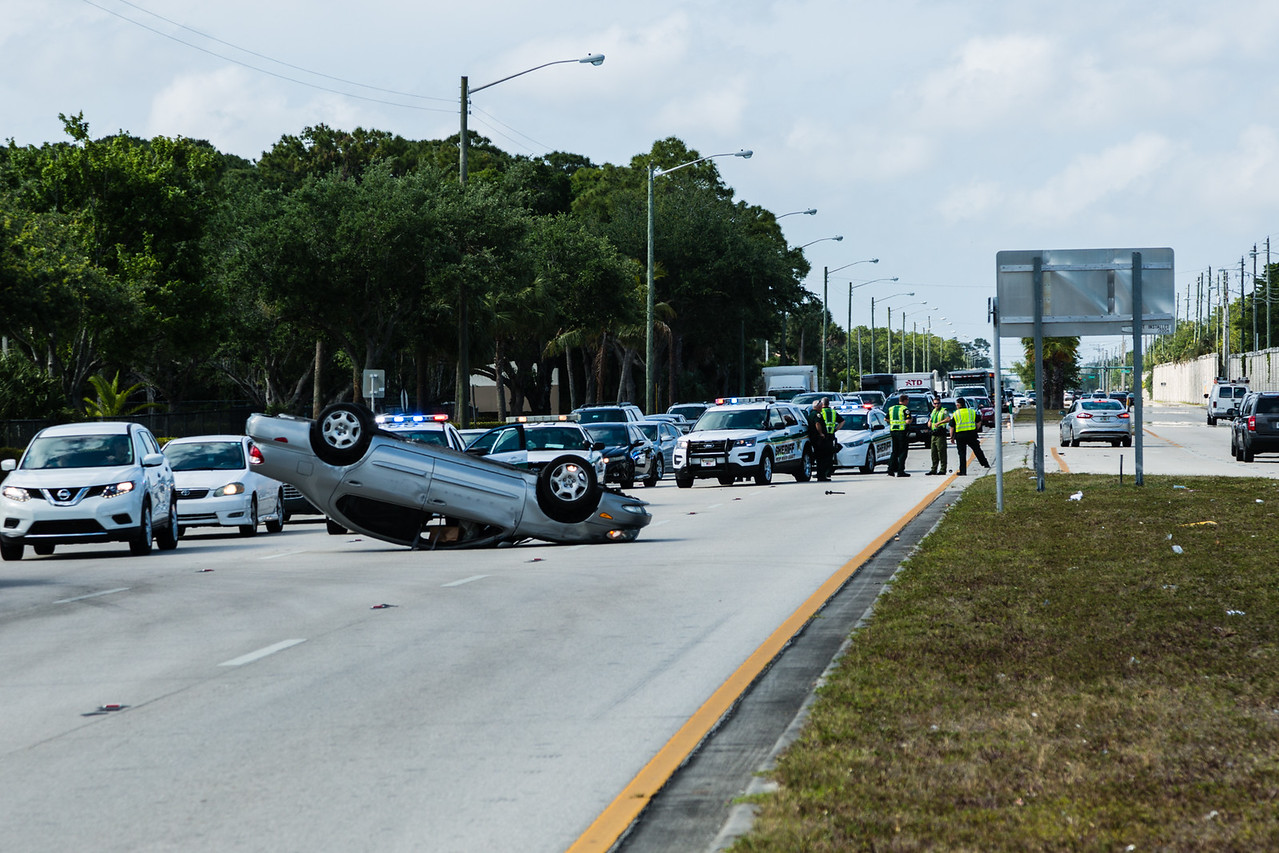 Rollover crash in front of Oxbridge Academy on N. Military Trail in West Palm Beach on Monday, May 5, 2016. (Joseph Forzano / The Palm Beach Post)