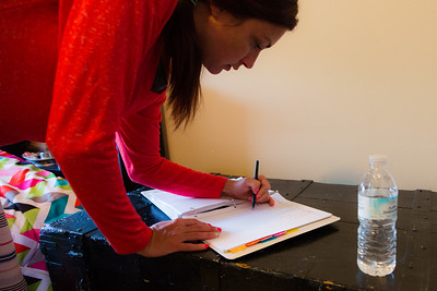 Kelly McEnna of Loxahatchee signs a log book, verifying that she received her daily prescriptions from house mother, Nita Reach (not pictured) on Wednesday, May 10, 2016.  The residents of the sober home must take their prescribed medication (mostly anti-depressants) in front of the house mother to ensure they are not hoarding their  medication. The medication is kept in a locked room that only Reach has access to. McEnna  has been a resident in the younger woman's sober home since April 2016 and is recovering from an opiate addiction. (Joseph Forzano / The Palm Beach Post)