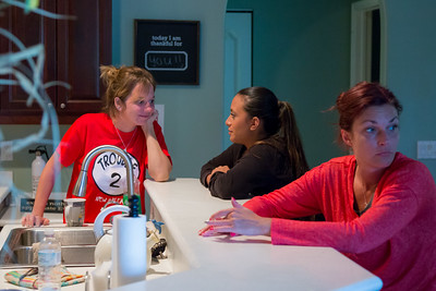 Eva Derrickson (left), 26,  Mariana Lovecchio (center), 28,  and Kelly McEnna (right), residents of the All About Recovery younger womens sober home in Loxahatchee, are waiting at the kitchen counter for a fresh pot of coffee to brew on Wednesday, May 10, 2016. (Joseph Forzano / The Palm Beach Post)