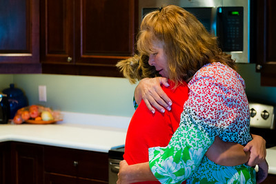 Georgia McGeeney (right), the owner of All About Recovery, gives Eva Derrickson a hug in the kitchen of the younger womems sober home in Loxahatchee on Wednesday, May 10, 2016. (Joseph Forzano / The Palm Beach Post)