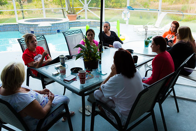 Residents of the younger womens sober home in Loxahatchee sit outside and discuss the morning meditation passage on Wednesday, May 10, 2016. Each morning a different inspirational passage is read and the residents discuss their thoughts on how the reading relates to them and their path to beating their addictions. (Joseph Forzano / The Palm Beach Post)