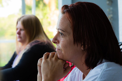 Nita Reach, 38, of Loxahatchee, listens while residents of the younger womens sober home relate how the morning mediation passage relates to them and their path to beating their addictions on Wednesday, May 10, 2016.  Reach is the 'house mother' for the younger womens sober home. Reach, a former alcholic, has been in the younger women's sober home since January 2015. (Joseph Forzano / The Palm Beach Post)