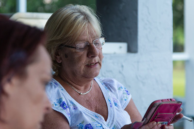 Kim Kilgore, 60, of Philadelphia, Pennsylvania, reads the morning meditation passage to the residents  living in the All About Recovery younger womens sober home in Loxahatchee, Florida on Wednesday, May 10, 2016. Kilgore is the house mother for the older women's sober home, also in Loxahatchee. (Joseph Forzano / The Palm Beach Post)