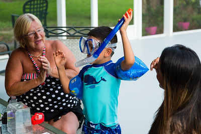 Sober home house mother Kim Kilgore, 60, claps as Mariana Lovecchio's son shows off his new snorkel, mask and water wings on Sunday, May 22, 2016 in Loxahatchee, FL. Sunday was Mariana's son's 6th birthday and the family celebrated at the sober home where Mariana currently resides. [PER MOTHER, DO NOT TO USE THE CHILD'S NAME IN THE CUTLINE] (Joseph Forzano / The Palm Beach Post)