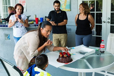 Mariana Lovecchio, 28, removes the candles from her son's birthday cake on Sunday, May 22, 2016 in Loxhatchee, FL. House mother Nita Reach, 38, Javier Valverde Jr. (Mariana's brother) and Clara Valverde (Mariana's mother) look on. Sunday was Mariana's son's 6th birthday and the family celebrated at the sober home where Mariana currently resides. [PER MOTHER, DO NOT TO USE THE CHILD'S NAME IN THE CUTLINE] (Joseph Forzano / The Palm Beach Post)