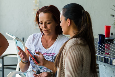 Mariana Lovecchio (right), 28, gives her smart phone to house mother Nita Reach (left), 38, so Reach can take pictures on Sunday, May 22, 2016 in Loxahatchee, FL. Sunday was Mariana's son's 6th birthday and the family celebrated at the sober home where Mariana currently resides. [PER MOTHER, DO NOT TO USE THE CHILD'S NAME IN THE CUTLINE] (Joseph Forzano / The Palm Beach Post)