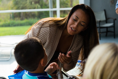 Mariana Lovecchio, 28, of Loxahatchee talks to her son on Sunday, May 22, 2016 in Loxahatchee, FL. Sunday was Mariana's son's 6th birthday and the family celebrated at the sober home where Mariana currently resides. [PER MOTHER, DO NOT TO USE THE CHILD'S NAME IN THE CUTLINE] (Joseph Forzano / The Palm Beach Post)