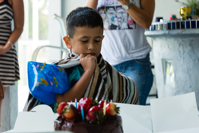 Wrapped in a towel after getting out of the pool, Mariana Lovecchio's son sits at the table in front of his birthday cake on Sunday, May 22, 2016. Sunday was Mariana's son's 6th birthday and the family celebrated at the sober home where Mariana currently resides. [PER MOTHER, DO NOT TO USE THE CHILD'S NAME IN THE CUTLINE] (Joseph Forzano / The Palm Beach Post)