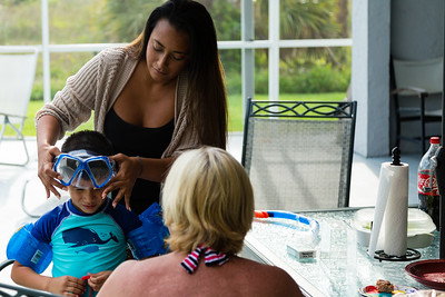 Mariana Lovecchio, 28, of Loxahatchee helps her son put on his new snorkel and mask on Sunday, May 22, 2016 in Loxahatchee, FL. Sunday was Mariana's son's 6th birthday and the family celebrated at the sober home where Mariana currently resides. [PER MOTHER, DO NOT TO USE THE CHILD'S NAME IN THE CUTLINE] (Joseph Forzano / The Palm Beach Post)