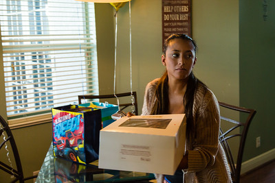 Mariana Lovecchio, 28, prepares to bring the birthday cake for her son outside on Sunday, May 22, 2016 in Loxahatchee, FL. Lovecchio, a former heroin addict, has been a resident in the younger women's sober home since December 2015 and has been sober for over 100 days. Sunday was Mariana's son's 6th birthday and the family celebrated at the sober home where Mariana currently resides. [PER MOTHER, DO NOT TO USE THE CHILD'S NAME IN THE CUTLINE] (Joseph Forzano / The Palm Beach Post)