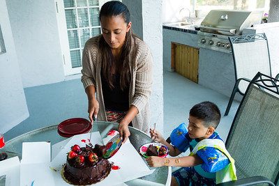 Mariana Lovecchio, 28, serves her son's birthday cake while her son watches on Sunday, May 22, 2016. Sunday was Mariana's son's 6th birthday and the family celebrated at the sober home where Mariana currently resides. [PER MOTHER, DO NOT TO USE THE CHILD'S NAME IN THE CUTLINE] (Joseph Forzano / The Palm Beach Post)