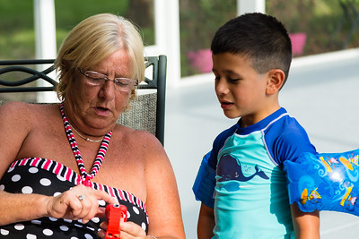 Mariana Lovecchio's son shows sober home  house mother Kim Kilgore, 60, his new child's smart watch on Sunday, May 22, 2016. Sunday was Mariana's son's 6th birthday and the family celebrated at the sober home where Mariana currently resides. [PER MOTHER, DO NOT TO USE THE CHILD'S NAME IN THE CUTLINE] (Joseph Forzano / The Palm Beach Post)
