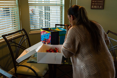 Mariana Lovecchio, 28, prepares the birthday cake for her son on Sunday, May 22, 2016 in Loxahatchee, FL. Lovecchio, a former heroin addict, has been a resident in the younger women's sober home since December 2015 and has been sober for over 100 days. Sunday was Mariana's son's 6th birthday and the family celebrated at the sober home where Mariana currently resides. [PER MOTHER, DO NOT TO USE THE CHILD'S NAME IN THE CUTLINE] (Joseph Forzano / The Palm Beach Post)