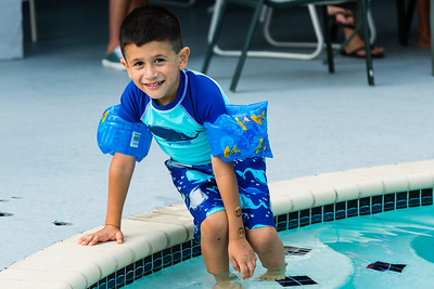 Mariana Lovecchio's son get in the pool at the sober home where Mariana resides on Sunday, May 22, 2016 in Loxahatchee, FL. Sunday was Mariana's son's 6th birthday and the family celebrated at the sober home where Mariana currently resides. [PER MOTHER, DO NOT TO USE THE CHILD'S NAME IN THE CUTLINE] (Joseph Forzano / The Palm Beach Post)