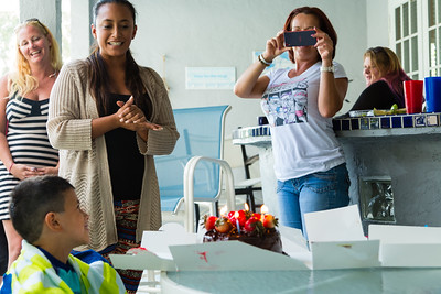 Erica Piotrowski (left), 36, Marianna Lovecchio (center), 28, sing happy birthday to Mariana's son, while house mother Nita Reach (right), 38, takes pictures and video on Sunday, May, 22, 2016 in Loxahatchee, FL. Sunday was Mariana's son's 6th birthday and the family celebrated at the sober home where Mariana currently resides. [PER MOTHER, DO NOT TO USE THE CHILD'S NAME IN THE CUTLINE] (Joseph Forzano / The Palm Beach Post)
