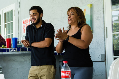 Javier Valverde Jr. (Mariana's brother) and Clara Valverde (Mariana's mother) sing happy birthday to Mariana's son on Sunday, May 22, 2016 in Loxahatchee, FL. Sunday was Mariana's son's 6th birthday and the family celebrated at the sober home where Mariana currently resides. [PER MOTHER, DO NOT TO USE THE CHILD'S NAME IN THE CUTLINE] (Joseph Forzano / The Palm Beach Post)