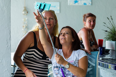 Sober home resident Erica Piotrowski, 36, and house mother Nita Reach, 38, take a selfie during Mariana Lovecchio's son's birthday party on Sunday, May 22, 2016 in Loxahatchee, FL. Sunday was Mariana's son's 6th birthday and the family celebrated at the sober home where Mariana currently resides. [PER MOTHER, DO NOT TO USE THE CHILD'S NAME IN THE CUTLINE] (Joseph Forzano / The Palm Beach Post)