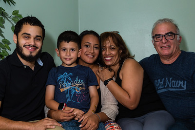 Mariana Locecchio's family on Sunday, May 22, 2016 in Loxahatchee, FL. From left to right: Javier Valverde Jr. (brother), Mariana's son, Mariana Lovecchio, Clara Valverde (mother)  and Javier Valverde Sr. (father). Lovecchio, a former heroin addict, has been a resident in the younger women's sober home since December 2015 and has been sober for over 100 days. The family celebrated Mariana's son's 6th birthday at the sober home where Mariana currently resides in Loxahatchee. [PER MOTHER, DO NOT TO USE THE CHILD'S NAME IN THE CUTLINE] (Joseph Forzano / The Palm Beach Post)
