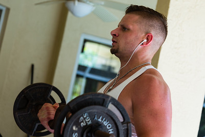 Brad Williams does curls at the All About Recovery younger men's home in Loxahatchee, Florida on Tuesday, May 24, 2016. Williams, 28, is originally from Tampa, Florida and was addicted to opiates. Williams is under court ordered rehab and has been in the All About Recovery younger men's home for over 90 days. (Joseph Forzano / The Palm Beach Post)