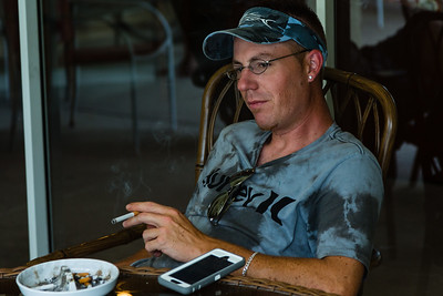 Daniel Shae smokes a cigarette on the patio at the All About Recovery younger men's home in Loxahatchee, Florida on Tuesday, May 24, 2016. Shae, 32, from The Acreage  in Palm Beach County, Florida, has been in the younger men's home for 2 1/2 months and is recovering from an opiate addiction. He's been clean for 2 1/2 months. Shae said he has lost five friends in two years to drugs and alcohol which helped in his decision to get clean. (Joseph Forzano / The Palm Beach Post)