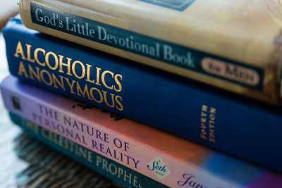 Inspirational books sit on a patio table at the All About Recovery older men's home in West Palm Beach, Florida on Tuesday, May 24, 2016. Various passages from the books are read during the morning meditation which happens every morning at 7 a.m. (Joseph Forzano / The Palm Beach Post)