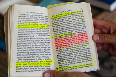 Highlighted passages in the Alcoholics Anonymous book that Peter reads from every day during his recovery at the All About Recovery older men's house in West Palm Beach, Florida on Tuesday, May 24, 2016. Peter, 55, is a recovering alcoholic originally from Seattle, Washington. [PETER DECLINED TO HAVE HIS PICTURE TAKEN AND DOES NOT WANT HIS LAST NAME USED.] (Joseph Forzano / The Palm Beach Post)
