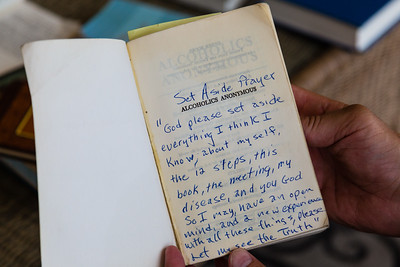 A prayer that Peter has written on the first page of an Alcoholics Anonymous book that he reads from every day during his recovery at the All About Recovery older men's house in West Palm Beach, Florida on Tuesday, May 24, 2016. Peter, 55, is a recovering alcoholic originally from Seattle, Washington. [PETER DECLINED TO HAVE HIS PICTURE TAKEN AND DOES NOT WANT HIS LAST NAME USED.] (Joseph Forzano / The Palm Beach Post)
