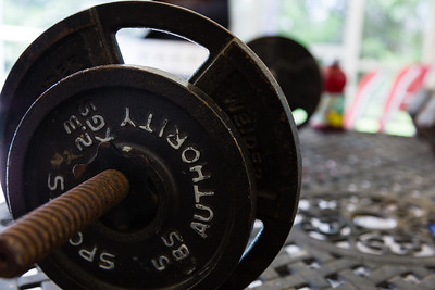 A barbell sits on a patio table at the All About Recovery younger men's home in Loxahatchee, Florida on Tuesday, May 24, 2016. Some of the residents spend their free time working out to help pass the time in the home when they are not in treatment. (Joseph Forzano / The Palm Beach Post)