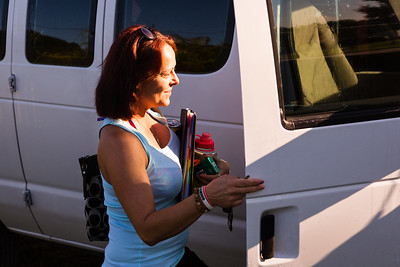 'House mom' Nita Reach prepares to climb into the door to the sober homes' passenger van on Tuesday, May 31, 2016. The house van will be used to transport the residents to All About Recovery's Intensive Outpatient Treatment Center in Royal Palm Beach. (Joseph Forzano / The Palm Beach Post)
