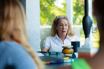 """New 'house mom' Karen Altieri Sharp, 56, from Philadelphia, Pennsylvania,  shares her thoughts on the morning meditation passage """"Keep it Simple"""" at the All About Recovery younger women's home in Loxahatchee, Florida on Tuesday, May 31, 2016. (Joseph Forzano / The Palm Beach Post)"""