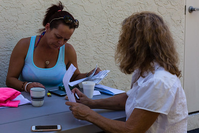 Nita Reach (left) and Karen Altieri Sharp go over paperwork at a picnic table behind the All About Recovery Intensive Outpatient Program center in Royal Palm Beach, Florida on Tuesday, May 31, 2016.  (Joseph Forzano / The Palm Beach Post)