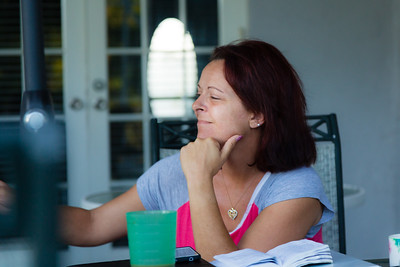 Nita Reach, 38, of Loxahatchee, listens while residents of the younger womens sober home relate how the morning mediation passage relates to them and their path to beating their addictions on Wednesday, May 31, 2016.  Reach is the 'house mother' for the younger womens sober home. Reach, a former alcholic, has been in the younger women's sober home since January 2015. (Joseph Forzano / The Palm Beach Post)