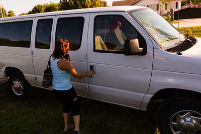 'House mom' Nita Reach unlocks the door to the sober homes' passenger van on Tuesday, May 31, 2016. The house van will be used to transport the residents to All About Recovery's Intensive Outpatient Treatment Center in Royal Palm Beach. (Joseph Forzano / The Palm Beach Post)