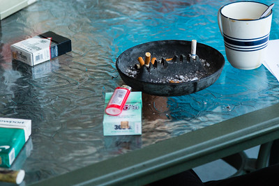 A coffee cup, packs of cigarettes and an ashtray sits on the patio table where the morning meditation passage was read at the All About Recovery younger women's sober home in Loxahatchee, Florida on Tuesday, May 31, 2016. (Joseph Forzano / The Palm Beach Post)