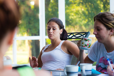 "Amy Kilgore (left) , 37, of Philadelphia, Pennsylvania, talks about how the morning meditation ""Keep it Simple"" relates to her and her path to recovery from heroin addiction on Tuesday, May 31, 2016. Eva Derrickson (right), 26, listens as she sips coffee.  (Joseph Forzano / The Palm Beach Post)"