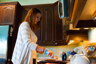 Shelby Sparrow, 21, of Plantation, Florida, prepares a dinner of pork chops and yellow rice for the residents of All About Recovery's younger women's sober home in Loxahatchee, Florida on Wednesday, June 1, 2016. Sparrow, a recovering heroin addict has been in the sober home since February 2016 and has been clean for five months. (Joseph Forzano / The Palm Beach Post)