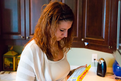 Shelby Sparrow, 21, of Plantation, Florida,  reads the cooking instructions on the package of yellow rice she is preparing to go with dinner for the residents of All About Recovery's younger women's sober home in Loxahatchee, Florida on Wednesday, June 1, 2016. Sparrow, a recovering heroin addict has been in the sober home since February 2016 and has been clean for five months. (Joseph Forzano / The Palm Beach Post)