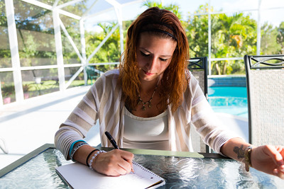 Shelby Sparrow, 21, of Plantation, Florida, writes in her journal at the All About Recovery younger women's sober home in Loxahatchee, Florida,  on Wednesday, June 21, 2016. Residents of the sober home are encouraged to keep a journal of their experiences, thoughts and feelings as they progress through their addiction recovery. (Joseph Forzano / The Palm Beach Post)