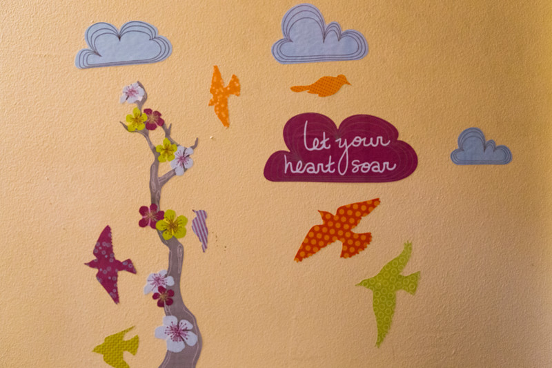 "Stencils and wall art that Clara Valverde put on the wall in the bathroom of the apartment where her daughter Mariana Lovecchio overdosed on December 11, 2015 at 6:30 a.m.  The inspirational message was meant to help remove the bad ""vibe"" from the bathroom where her daughter almost died. Photo taken on June 7, 2016. (Joseph Forzano / The Palm Beach Post)"