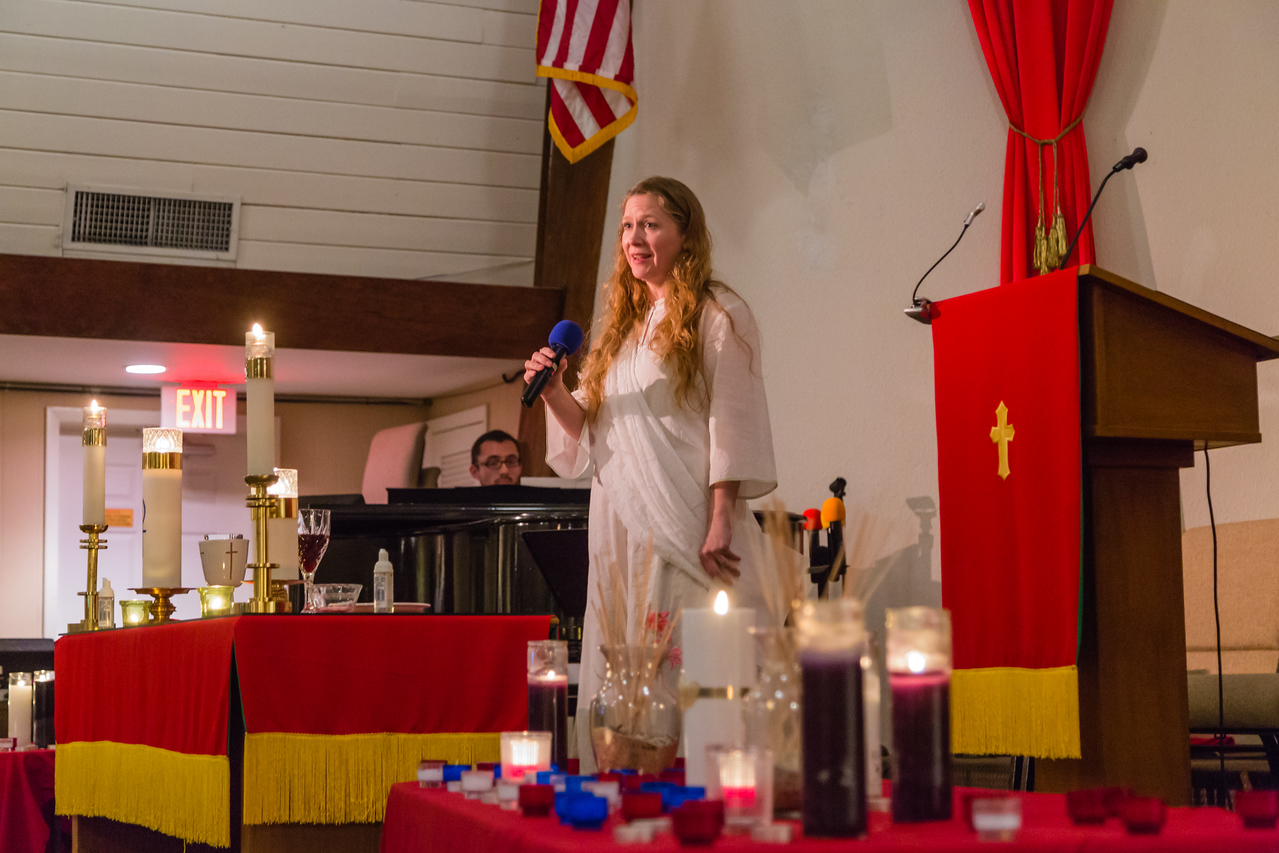 """Sarah-Helen Land sings """"Be not Afraid"""" to the congregation gathered for the prayer service for the Orlando mass shooting victims at the Metropolitan Community Church in Palm Beach Gardens on June 12, 2016. (Joseph Forzano / The Palm Beach Post)"""