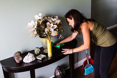 "Amy Kilgore, 37, of Philadelphia, Pennsylvania cleans the side table in the foyer at the All About Recovery younger women's sober home in Loxahatchee, Florida on Friday, June 24, 2016. Residents are required to keep the sober home clean, but once a week, the residents  are assigned an area of the sober house to ""deep clean"". (Joseph Forzano / The Palm Beach Post)"