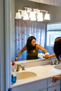 "Amy Kilgore, 37, of Philadelphia, Pennsylvania cleans the bathroom at the All About Recovery younger women's sober home in Loxahatchee, Florida on Friday, June 24, 2016. Residents are required to keep the sober home clean, but once a week, the residents  are assigned an area of the sober house to ""deep clean"". (Joseph Forzano / The Palm Beach Post)"