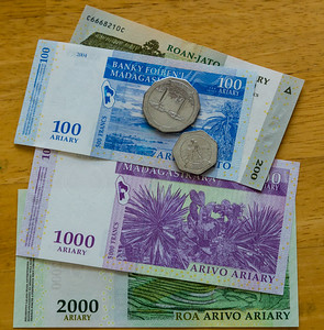 "Some of the currency of Madagascar (called Ariary) that Jenny Mullins brought home after serving the Mercy Ship ""The African Mercy'. Mullins served for 10 months on the hospital ship, which treated just under 1,500 patients for varying ailments. Photo taken on Wednesday, July 13, 2016, in Jenny's home in Royal Palm Beach, Florida. (Joseph Forzano / The Palm Beach Post)"