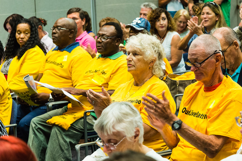 "Supports of ""#ourlivesmatter"" attend the South Florida Water Management District's monthly Governing Board Meeting wear yellow #ourlivesmatter t-shirts,  on Thursday, July 14, 2016. Residents of Belle Glade, Clewiston, Moorehaven, Pahokee and South Bay are not in favor of the state purchasing land south of Lake Okeechobee. (Joseph Forzano / The Palm Beach Post)"
