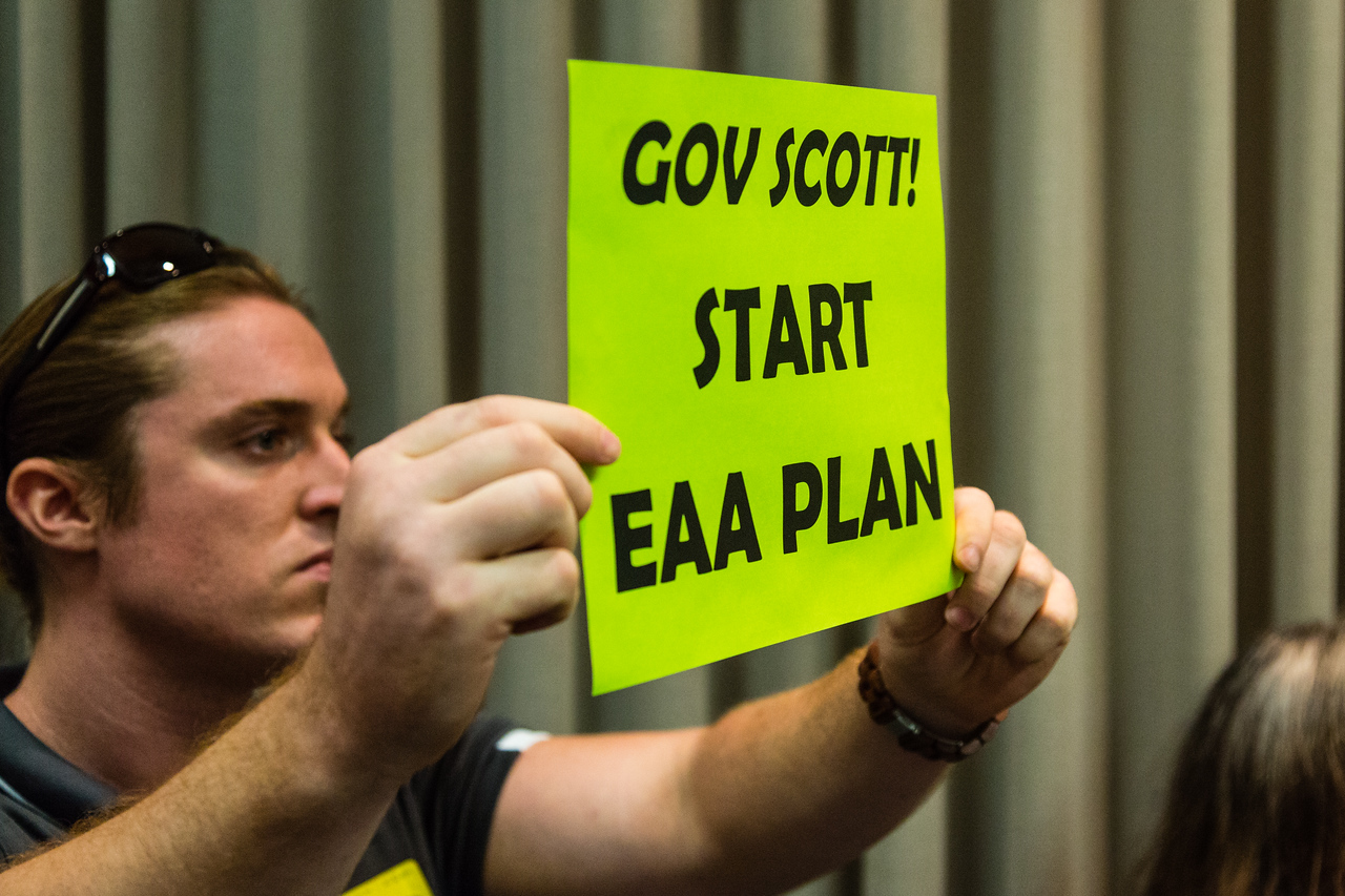 Patrick Ferguson of the Sierra Club holds a sign reading 'Gov Scott! Start EAA Plan'. The Sierra Club's Everglades Restoration Campaign wants the state to purchase land south of Lake Okeechobee to help restore degraded freshwater and marine life in South Florida.  (Joseph Forzano / The Palm Beach Post)
