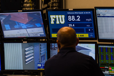 Walter Conklin, Lab Manager, is at the controls running the first demonstration test in the Wall of Wind control room at the FIU Engineering Center in Miami Dade on Wednesday, July 27, 2016. FIU hosted a demonstration to show the impact of hurricane-force winds on a scaled down model home. (Joseph Forzano / The Palm Beach Post)